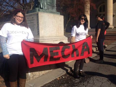 "MEChA, or Movimiento Estudiantil Chicano de Aztlan, organized a two-hour silent demonstration on Cornell University's Arts Quad on November 20, 2013, protesting against a racist game criminalizing undocumented immigrants at UT Austin. CUSLAR student interns Kimberly Cardenas and Diana Folla stand holding a poster of MEChA, wearing  shirts that say ""Undocumented"" in the front and ""No Human Being Is Illegal"" in the back, to illustrate their solidarity. Photo: MEChA."
