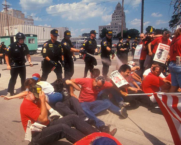 Decatur, Illinois - Police use pepper spray on locked-out workers at the A.E. Staley Co. The workers and their supporters were peacefully sitting in the driveway at the Staley plant as an act of civil disobedience to protest the lockout.Copyright © Jim West